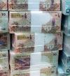 بنوك أجنبية تبدأ مقاطعة الريال القطرى