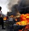 قتيل وجرحى بمواجهات المتظاهرين وقوات الأمن فى بغداد