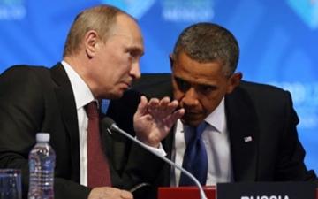 أوباما يبرر العقوبات على روسيا.. وبوتين: العلاقات يجب ألا تتأثر بأوكرانيا