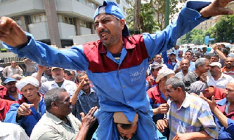 إضراب عمال الهيئة العامة للنظافة بالجيزة   