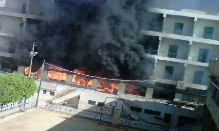 الإخوان تحرق مدرسة بالمنيا اعترضا على إعدام 528