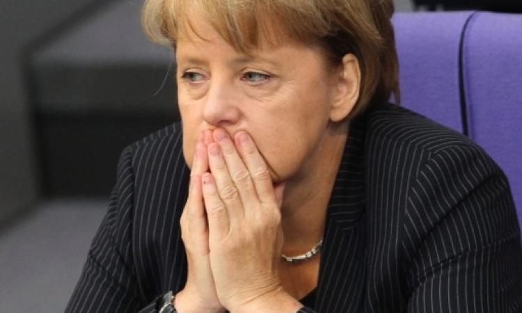 ميركل تهدد روسيا بعقوبات جديدة