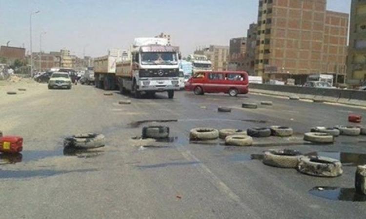 الأمن يفتح الطريق الدائري بمنطقة الوراق بعد قطعه من قبل الإخوان