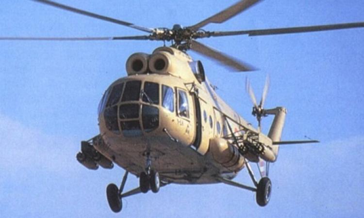 طائرات الهليكوبتر تلقى بكروت هدايا بالميادين الرئيسية بمناسبة احتفالات أكتوبر