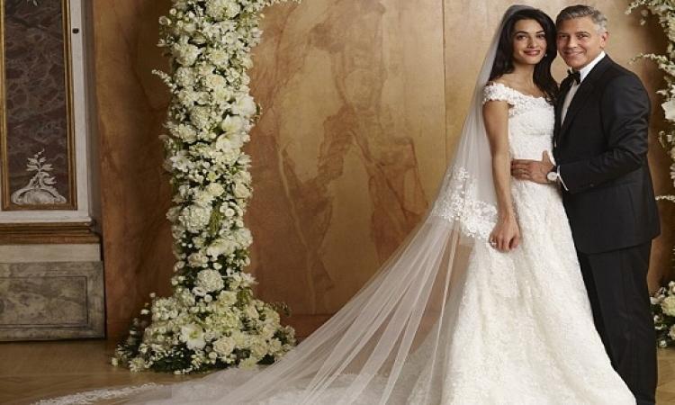 كلونى وأمل ينشران صورا جديدة لحفل زواجهما بينها .. صور رقصة الزفاف
