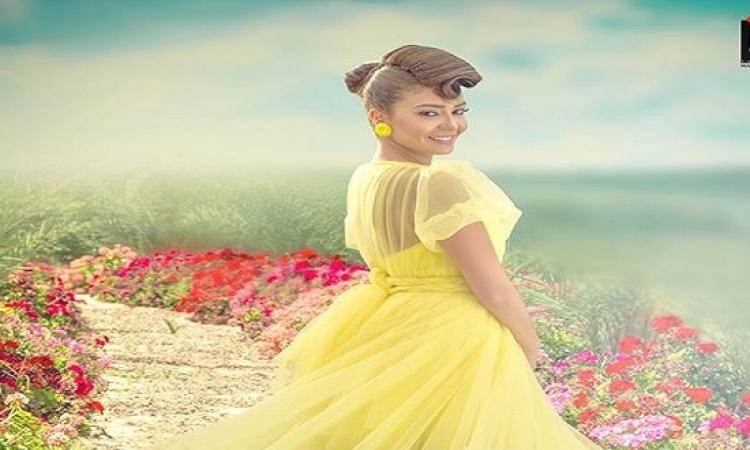 ميرنا المهندس تتألق بفستان أصفر فى أحدث  جلسة تصوير لها