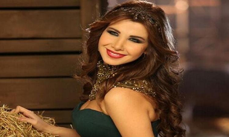 بالصور .. نانسى عجرم تتألق فى حفل BIAF 2015