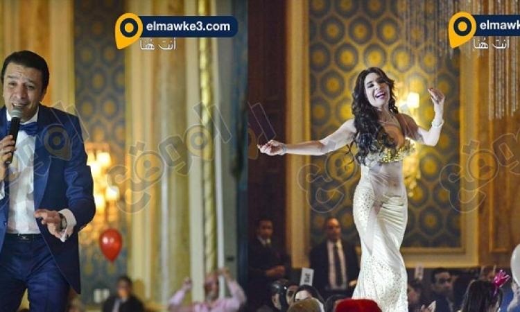 بالصور .. الراقصة دينا و مصطفى كامل يشعلان فندق سميراميس فى راس السنة