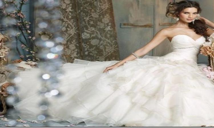 بالصور .. مجموعة فساتين الزفاف ذات الطلة الملكية