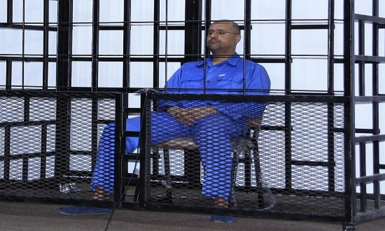 محامى نجل القذافى: محاكمة موكلى بالإعدام غيابيًا صورية وغير قانونية