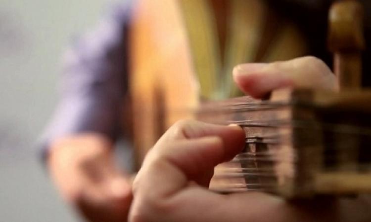 أكثر من ٢٠٠٠ عازف صينى يدخلون موسوعة جينيس لعزفهم العود الصينى