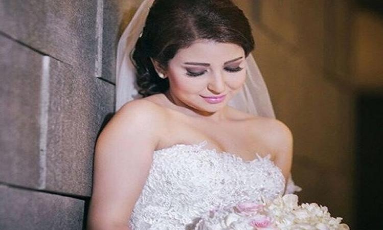 بالصور .. علياء عساف تعلن انفصالها على صورة زفافها !!