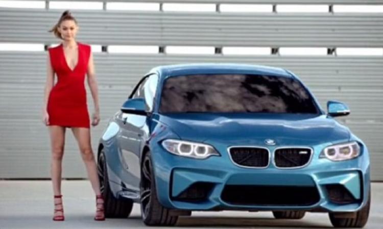 بالصور .. جيجى حديد مثيرة بالأحمر فى إعلان سيارات !!