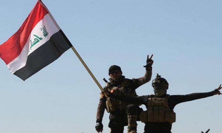 رفع العلم العراقى فوق مسجد البغدادى بوسط الموصل