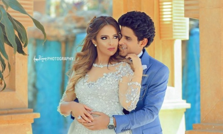 بالصور .. جلسة تصوير للعريسين حمدى الميرغنى وإسراء عبد الفتاح
