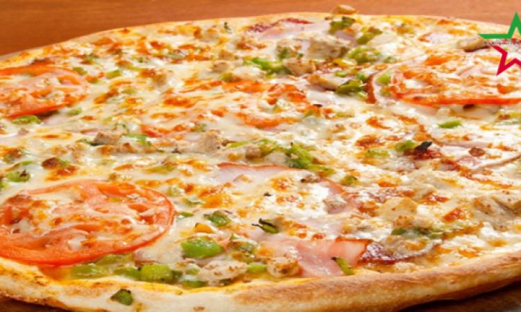من المطبخ الإيطالى .. بيتزا الأجبان الأربعة