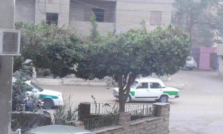 بالصور ..أمطار غزيرة على محافظة الفيوم والاهالى يهربون من  الشوارع