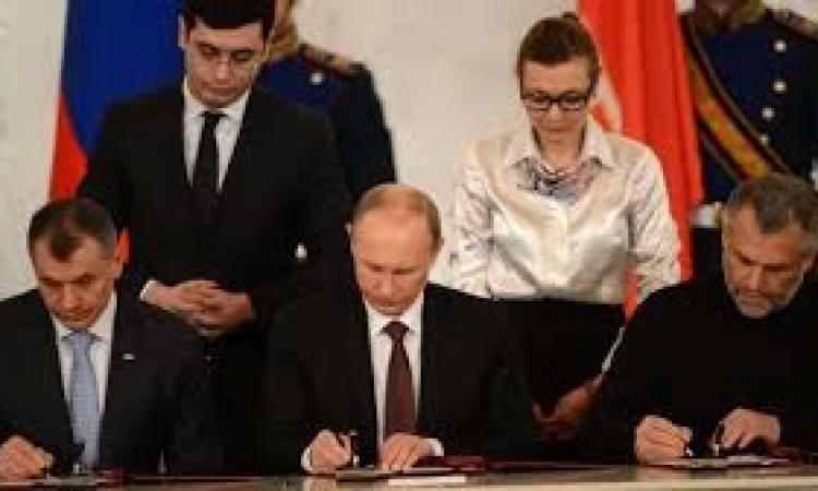 بوتين يوقع رسميا على مرسوم ضم القرم إلى الاتحاد الروسي