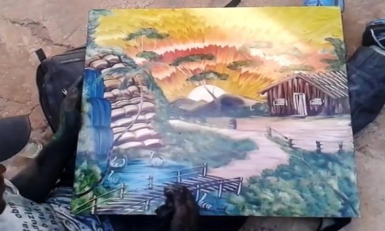 بالفيديو .. إبداع رسام فى أسرع رسم بإستخدام الأصابع