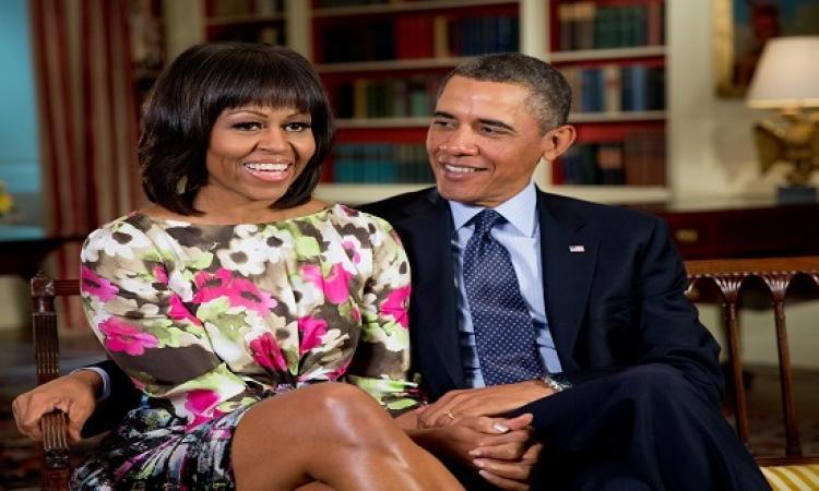 """""""ايام الكحرتة"""" .. ميشيل أوباما تحتفل بالكريسماس بصورة مع زوجها على Twitter"""