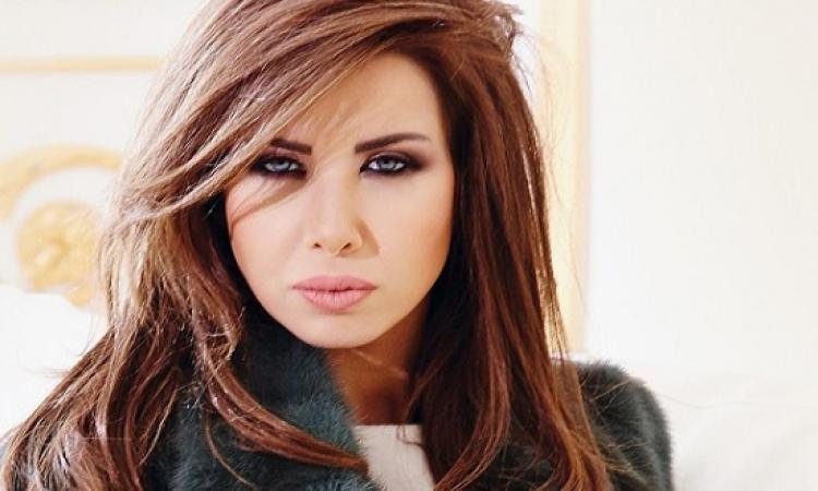 بالصور.. نانسى عجرم تهاجم المسئولين فى لبنان بسبب العاصفة نورما
