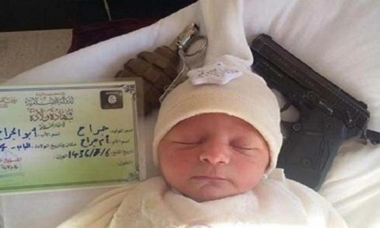 بالصور.. أول مولود داعشى فى الدولة الاسلامية..دمروا صورة الملاك بالقنابل والرشاشات