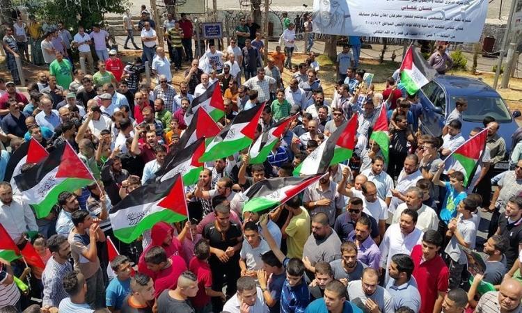 بالصور..  مظاهرات منددة بحرق الرضيع الفلسطينى