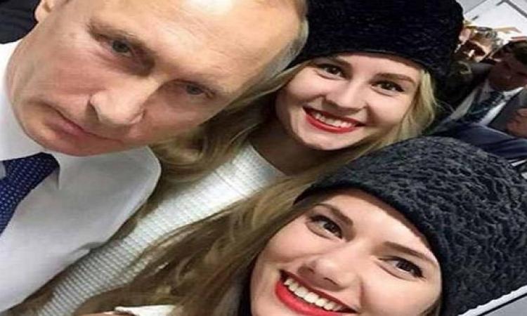 بوتين بسلفى مع ملكة جمال روسيا ولكنه غير سعيد  .. يا ترى إيه السبب!!
