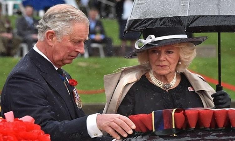 بالصور.. الأمير تشارلز وزوجته تحت الأمطار من أجل ذكرى الحرب فى كانبرا