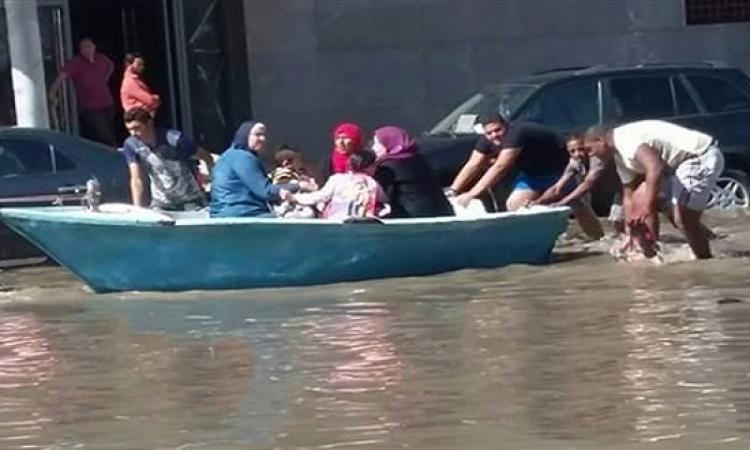 بالصور .. وانا لسه قادر فى المطر انزل : المصريين مبيفرقش معاهم حاجة !!