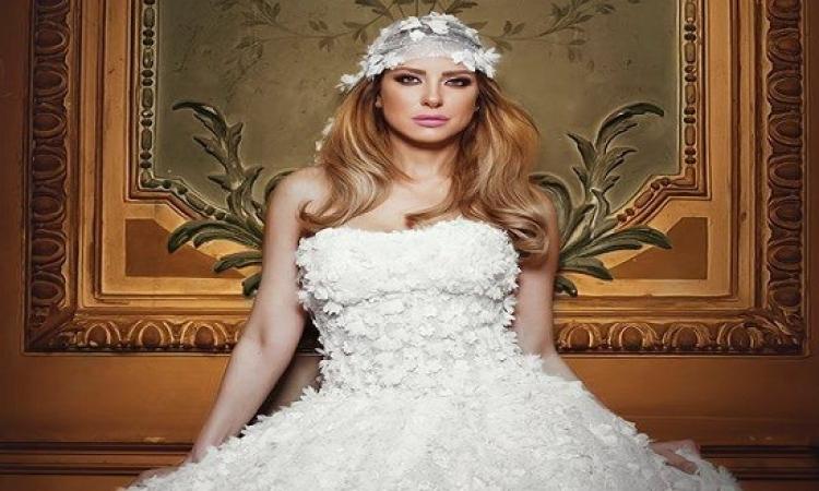 بالصور .. ريم مصطفى تتألق بالفستان الأبيض