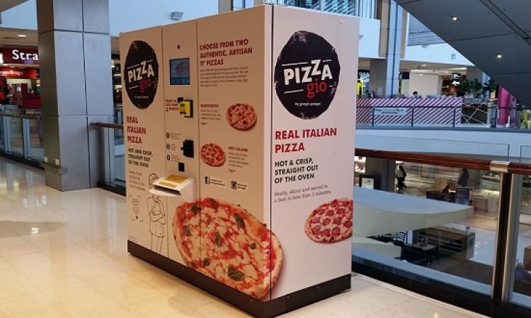 أول جهاز صراف آلى يقدم البيتزا بدلا من النقود