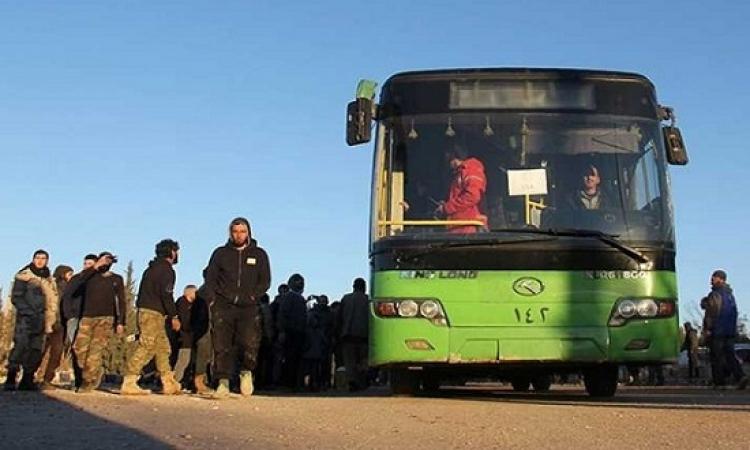 خروج الدفعة الرابعة للمسلحين من حى الوعر بحمص