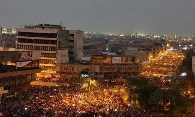 آلاف العراقيين يتحدون حظر التجول فى بغداد