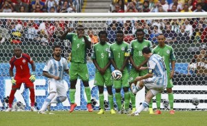 Argentina's Lionel Messi scores on a free kick during the 2014 World Cup Group F soccer match against Nigeria at the Beira Rio stadium in Porto Alegre