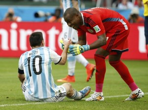 Nigeria's goalkeeper Vincent Enyeama helps Argentina's Lionel Messi up during their 2014 World Cup Group F soccer match at the Beira Rio stadium in Porto Alegre