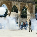 Palestinian protesters react during clashes in Jerusalem's Old City