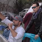 حكيم يقف خلف المخرج أحمد عبد الجواد