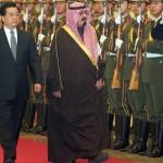 Visiting Saudi King Abdullah (C) walks b