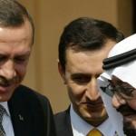 Saudi Arabia's King Abdullah (R) talks w