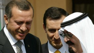 Saudi Arabia's King Abdullah (R) talks w