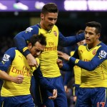 Arsenal's Santi Cazorla celebrates his goal from a penalty with teammates during their English Premier League soccer match against Manchester City in Manchester