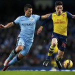 Arsenal's Hector Bellerin is challenged by Manchester City's Sergio Aguero during their English Premier League soccer match in Manchester