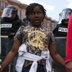 demonstrators-hold-hands-front-police