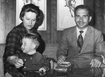 FILE -- King Hussein of Jordan and his wife Princess Muna pose with their son, Crown Prince Abdullah, at the Raghdan Place Near Amman, in this March 26,  1963 file photo. The king died at Sunday morning, Feb.7, 1999, in his bed at the King Hussein Medical City hospital, a senior government official said. The King was 63. (AP Photo/JIM PRINGLE)
